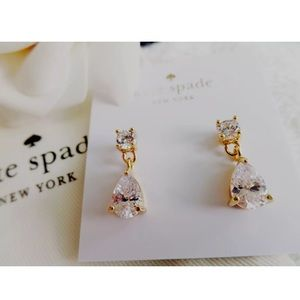 Kate Spade Gold tone plate/cubic zirconia